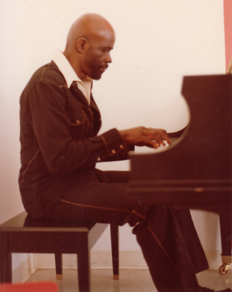 Makanda at the piano in his office studio, College at Old Westbury, 1981