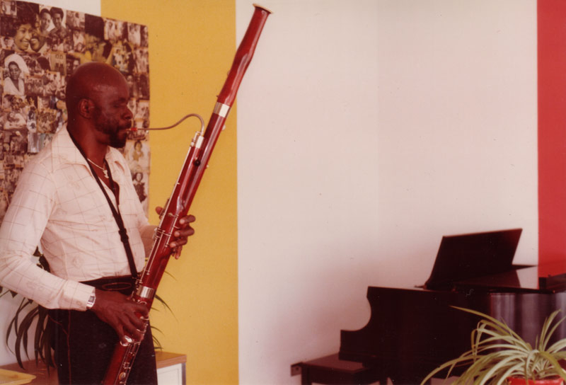 Makanda playing the bassoon in his office studio, College at Old Westbury, 1981