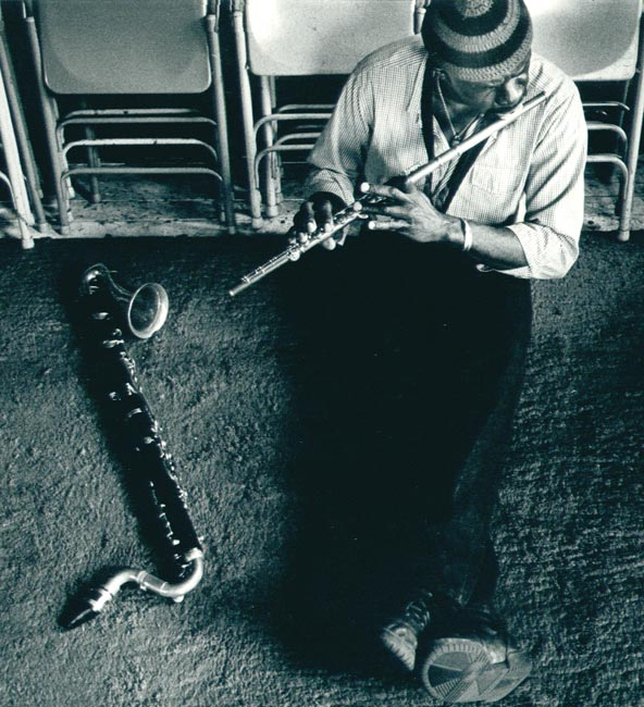 Makanda Ken McIntyre playing the flute in his Studio on West Broadway, NYC, 1980s