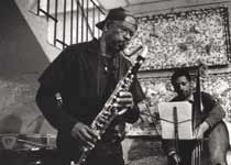Makanda playing the bass clarinet with bassist James Lewis at Chez Dolores, Paris, May 22, 1996, photo by Bernard Ailloud