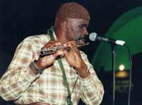 Makanda Ken McIntyre playing the flute, Kwanzaa celebration, Museum of Natural History, NYC, Dec., 2000